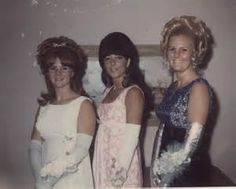 Going all out or some prom with long gloves, wrist corsages, long evening wear and huge hair.