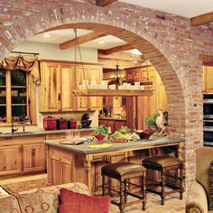 Salvaged Wood #Kitchen | The builder used aged cypress, salvaged from an old mill, to construct the kitchen cabinets and for facing some of the appliances, such as the icemaker and refrigerator.