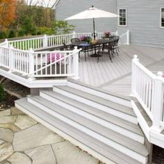A raised deck with flared steps also showcases a center parting board, two two colors and contrasting rails.