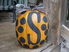 painted pumpkin ~~ One for each member of your family or just one with the letter of your family's last name :)