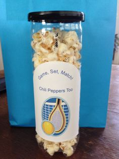 Gift for tennis team.  I would have to imagine the can smells like tennis balls but I could see putting the popcorn/treat inside a clear bag and then in the can.