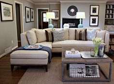 Classic Sectional--neutral/blue colour scheme; also like the rustic coffee table & wire magazine storage underneath.