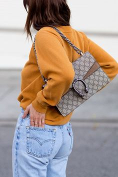 jeans, Gucci bag and mustard sweater