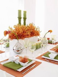 love this modern and edgy centerpiece! The green and orange work well with the white and silver.