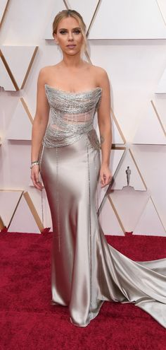 Actress Scarlett Johansson in a shimmery silver satin gown with a mesh bodice featuring silver draped fabric attends the 2020 Vanity Fair Oscar Party hosted by Satin Gown, Satin Dresses, Strapless Dress Formal, Gowns, Formal Dresses, Christian Siriano, Christian Dior, Armani Prive, Jane Fonda