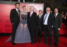 Liam Hemsworth, Jennifer Lawrence, Donald Sutherland, Josh Hutcherson, Phillip Seymour Hoffman, and Stanley Tucci at the premiere of The Hunger Games: Catching Fire at the Nokia Theatre in Los Angeles, CA on 11/18/13.