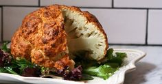 Spicy Whole Roasted Cauliflower Recipes PureWow Whole Roasted Cauliflower, Cauliflower Recipes, Vegetable Recipes, Vegetarian Recipes, Cooking Recipes, Healthy Recipes, Roasted Califlower, Parmesan Cauliflower, Cauliflower Steaks