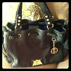Very nice size bag excellent condition I used once Nice bag has nylon and bows on each side And leather handles Juicy Couture Bags Totes