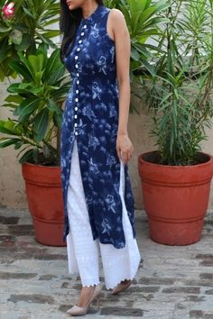As temperature rises a few digits, it's time to acquire a whole new wardrobe with this beautiful Blue Tropical Print Modal Rayon Kurti with White Chikankari Full Lining Cotton Palazzo with pocket from Colorauction. The Modal Rayon fabric makes this kurti Simple Kurti Designs, New Kurti Designs, Salwar Designs, Kurta Designs Women, Kurti Designs Party Wear, Dress Designs, Kurta Patterns, Dress Indian Style, Indian Wear