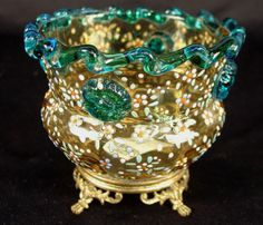 Moser rose bowl in footed brass frame, amber color with en glass knobs, turquoise amel applied flowers and applied turquoise glass knobs, turquoise trrim around top