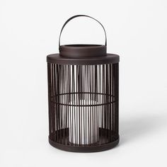 Update your outdoor decor with the Vertical-Weave LED Battery-Operated Outdoor Lantern from Threshold™. This neutral outdoor lantern includes a white LED. Outdoor Post Lights, Outdoor Lighting, Outdoor Lantern, Outdoor Decor, Exterior Light Fixtures, Lantern String Lights, Umbrella Lights, Tiki Torches, Lantern Candle Holders