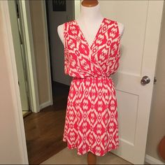 Anthropologie printed dress Anthropologie printed dress with stretch waist, billowy flattering upper fit, and deep v neck and back. Gorgeous red and white ikat print. Skirt is fully lined. Hand wash only. Made in USA. Excellent used condition - worn once. Sizing is generous due to stretch waist - could also fit an XL. Anthropologie Dresses