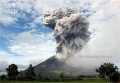 Mexico's Colima Volcano sends exhalation two miles high