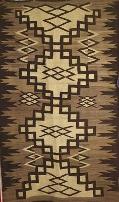I like the older Navajo weaving with natural or earthtone colors. A little wear is fine.
