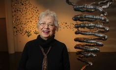 Local artist Anita Valencia stands by her exhibit on display at the Southwest School of Art's Russell Hill Rogers Gallery. Valencia's works of art are made from aluminum cans and depict a tornado, stars, butterflies and other objects. Photo: JOHN DAVENPORT, San Antonio Express-News