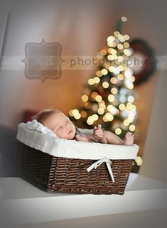 This is a much better take on the Christmas photo idea! Since my son will only be 4 months old when it comes around this laying in a basket idea seems much easier to do. Just gotta figure out what type of basket/present box type of thing to put him in.