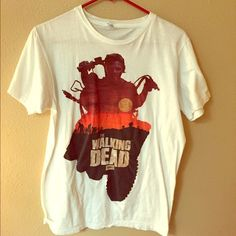 The Walking Dead , short sleeve shirt! This is a medium T-shirt that I bought from hot topic, this particular shirt features Daryl  must have for any TWD fan! Hot Topic Tops
