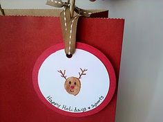 Kid made thumb print gift tag - great idea for family gifts