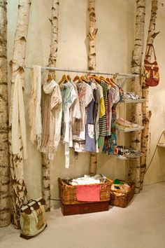 why not make it a room full of trees with clothing, accessoires and jewelry?