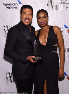She has company! Hudson was more than happy to pose with music legend Lionel Richie...
