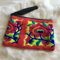 Frida Kahlo Style Wristlet Love that Frida Kahlo look? This gorgeous, brightly colored wristlet was hand made in Thailand. I brought it back from a recent trip. Add some style to your jeans and t-shirt! Brand new, never used. Other styles and colors posted in separate listings. Bags Clutches & Wristlets
