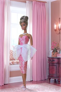Elegant in pink. In this photo: Evening Gown Barbie® doll is wearing a pink silk brocade strapless cocktail dress with a dramatic organza bow from Bellissima Couture. I am a huge fan of Hilda's exquisite doll fashions.