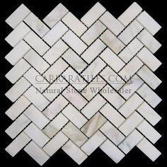 (http://www.carraratiles.com/calacatta-gold-italian-marble-herringbone-mosaic-tile-honed.html)