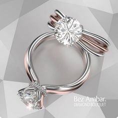 A round center set in a rose and white gold three roe split shank. #diamondjewelry #engagementrings www.bezambar.com