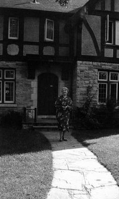 Lucy Maud Montgomery in front of her home, 'Journey's End' in Toronto, Ontario. She passed away there in 1942.