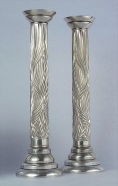 'Chased' silver candlesticks by Wally Gilbert.