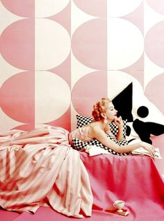 Model wearing Claire McCardell's pink and white striped dress photographed by Richard Rutledge.... VOGUE,1952
