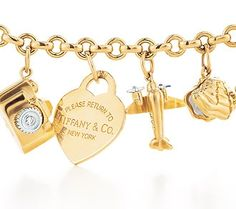 Charmed I'm sure!  I love love love 14k gold charms and my charm bracelet!
