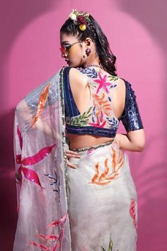White saree with allover floral motif sequin work. Comes with blue embellished blouse. Embroidered NecklineLeaf Sleeve LengthHalf FabricOrganzalycra net shantoon ColorWhite Cutout back Sheer panel Saree Blouse Neck Designs, Stylish Blouse Design, Fancy Blouse Designs, Sari Design, Saree Trends, Organza Saree, Designer Blouse Patterns, Indian Designer Outfits, Lifestyle