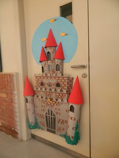 May first look red cones add to the walls and door sides with round paper that looks like towers of the castle