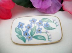 Vintage handmade blue floral ceramic brooch by ALEXLITTLETHINGS, $12.00