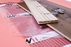 A close up image of Allbrite's electric ribbon underfloor heating system with engineered board Electric Underfloor Heating, Underfloor Heating Systems, Types Of Flooring, Engineering, Ribbon, Board, Image, Tape, Band