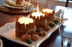 So smart...take cheapo candles and surround with cinnamon sticks for a house filled with cinnamon scent!