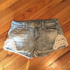 "Sale | AE Jean Shorts Really cute American Eagle jean shorts with crochet detail. Only worn twice, no flaws. Distressed/frayed hem. Lighter wash. 14"" waist, 8"" rise & 2"" inseam.  Please ask any questions prior to purchasing - all sales are final.  • Bundle discounts • Fast shipping • No trades / no holds  ⭐️Now FIRM unless bundled⭐️ American Eagle Outfitters Shorts Jean Shorts"