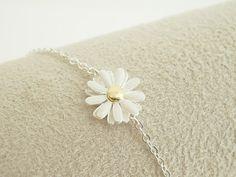 Daisy bracelet in silver, flower bracelet, everyday jewelry, bridal jewelry, bridesmaid jewelry. $14.50, via Etsy.
