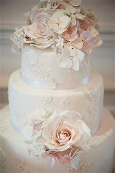Traditional floral wedding cake..Elizabeth's Cake Emporium  If you're a fan of tradition, you'll love this beautifully decorated wedding cake from Elizabeth's Cake Emporium. Why not ask if the subtle lace detailing on the cake can match the lace of your wedding dress?