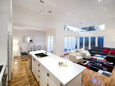 Modern dining room idea with carpet & bi-fold doors - Dining Room Photo 164736