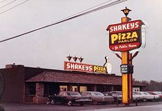 """The Original (and first) Shakey's Pizza. The history of Shakey's Pizza Parlor begins in 1954, when Sherwood """"Shakey"""" Johnson opened the first Shakey's Pizza Parlor® in a remodeled grocery store on 57th and J Street in Sacramento, California."""