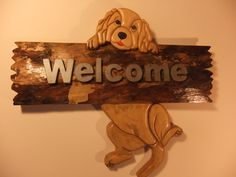 Dog swinging on the welcome sign