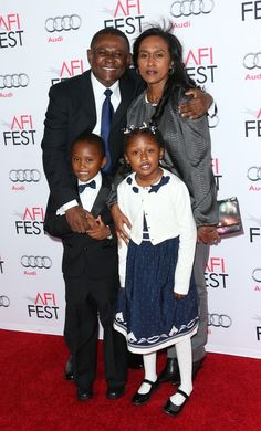 """Dr. Omalu and family. The brilliant doctor that discovered CTE in pro football players. Will Smith played him in the 2015 movie """"Concussion."""""""