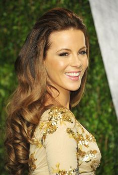 Brides.com: 16 Must-See Beach Wedding Hairstyles. Kate Beckinsale's Romantic, Half-Up Look. For a half-up look, we adore this brunette Brit's beachy-looking hairstyle choice. She only pulled back the very front, letting the rest of her gorgeous long hair fall down past her shoulders. See more half-up wedding hairstyle ideas.