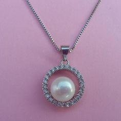 Colgante de plata y perla cultivada redondo