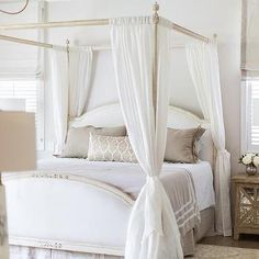French Canopy Bed with Sheer Curtains Tied to Posts