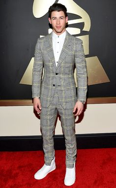 """Nick Jonas from Best Dressed Men at the 2015 Grammys We're sure quite a few fellas are """"Jealous"""" of the singer's grey plaid Versace getup."""