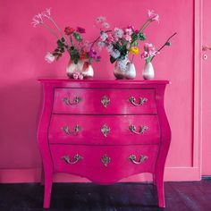 Paint an antique dresser an unusual color like hot pink!