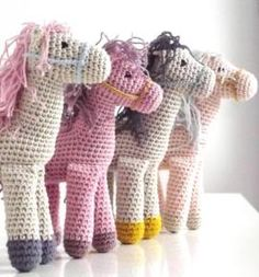 Crochet horses.  Although mine were knitted, these remind me of a certain little horsey I made for my niece many years ago.